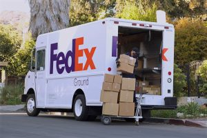 Los,Angeles,-,February,26,,2021:,Fedex,Driver,Loading,Boxes